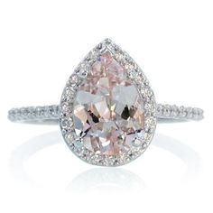 14K White Gold Pear Cut Morganite Engagement Ring Shape Diamond Halo Alternative Engagement Solitaire Wedding Anniversary Gemstone Ring. $1,100.00, via Etsy.
