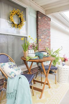 Front Porch Seating area decorated for spring with navy, aqua and pops of yellow Porch Decorating, Decorating Your Home, Diy Home Decor, Decorating Ideas, Decor Ideas, Front Porch Seating, Patio House Ideas, Patio Ideas, Porch Ideas