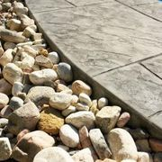 How to Put in Rock Landscaping | eHow