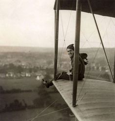 """Aviation. Planes. Graham-White five persons biplane…A venturing neck crawls during the flight to the extreme..of the wing, 1913. Place unknown"" (translated, via)"