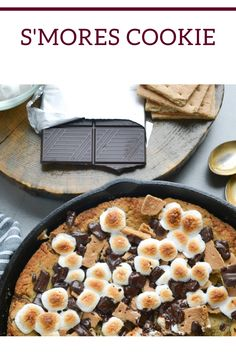 S'mores Cookie is a soft and chewy cookie baked in a cast-iron skillet topped with graham crackers, chunks of melted chocolate, and gooey toasted marshmallows. Delicious Cookie Recipes, Best Cookie Recipes, Yummy Cookies, Baking Recipes, Sweet Recipes, Vegan Recipes, Bar Recipes, Yummy Food, Easy Desserts