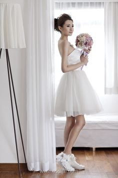 Gown: Ballerina style short wedding dressDescriptions: Dress with tulle layers and satin bow detail, perfect for a cocktail wedding partyPrice: HK$1,500photography: Nova Sy@ reverseconcept model: Eva Liu@ starz peoplemakeup