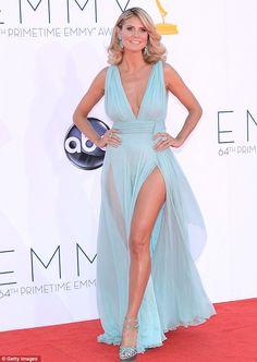 Model behaviour: Heidi Klum wore a sea foam Alexandre Vauthier frock, with daring thigh slash.