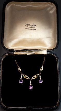 A Delicate Art Nouveau Gold, Amethyst, White Opaque Enamel and Diamond Necklace circa 1908. Made in Europe and imported to Russia between 1908 and 1917.   $2,900.00