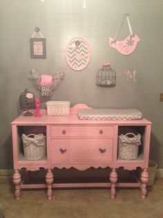 Old sideboard beautifully upcycled into storage and baby changing area.