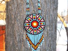 native american beadwork  approx. 27 necklace  approx. 2 1/2 dia.with deer skin back and DC stamp on it.  100 % native american made  Member of the