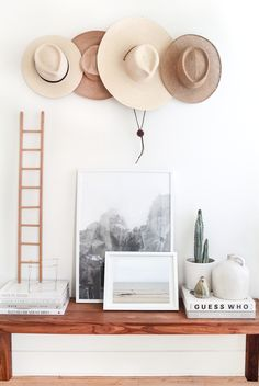 Gorgeous entry. I love the look and feel of having hats on display. They help make a house feel like a home.