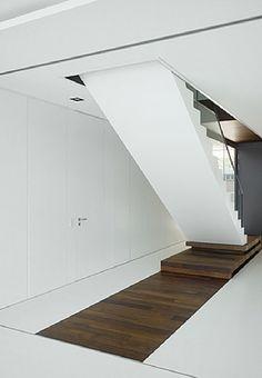 Pure white and dark wood, Villa Griebnitzee in Germany by Axthelm & Rolvien Architekten _