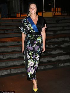 Sensational! Iskra Lawrence ditched her usual two-pieces for a demure floral jumpsuit as she attended the DVF Awards in New York on Thursday