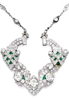 PLATINUM, DIAMOND AND EMERALD NECKLACE-BROOCH COMBINATION The pendant set with three old European-cut diamonds weighing approximately 1.95 carats, suspended from a delicate chain composed of lonzenge-shaped links, the pendant and chain further set with numerous baguette, old European and single-cut diamonds weighing approximately 4.50 carats, decorated with calibré-cut emeralds, length 14½ inches; circa 1925.