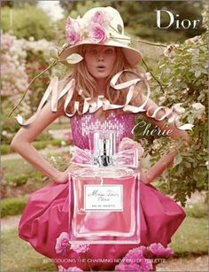 This ad is portraying a hyper-feminine message by using pink as the prominent color; pink flowers, pink outfit, pink perfume bottle, pink font.  There is however, something unusual going on. Despite the surprised, and somewhat stupid, look on her face, the model is facing the audience; no canting, with her hands defiantly placed on her hips.