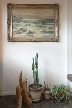 Potted cacti and lovely painting - This is a great setting for your foyer. Welcoming and warm!