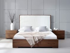 Bella Natural Walnut Bed with Faux-leather headboard. The natural walnut veneer frame provides a contrast to the headboard of this beautifully modern bed.