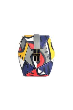 Angel Jackson | ABSTRACT ATOMIC BOX BAG IN MULTI SHEEP LEATHER APPLIQUE £245 A kaleidoscope of colours in sheep leather applique, this bag fits perfectly into the print and pattern trend this season. Removable chain strap means it can be worn either as a satchel or a clutch. Signature Angel Jackson gold hardware closure. Angel Jackson signature Samaya Clasp Measures: 18CM (W) X 18CM (H) X 3CM (D) Chain strap with leather shoulder patch. Length: 113cm  No interior pocket Cotton canvas lining