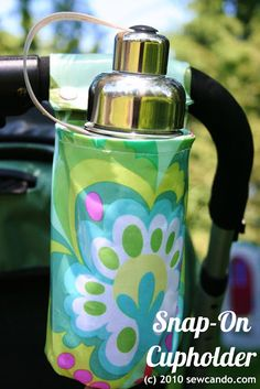 Always losing your water bottle or sippy cups while out and about? Whip up one of these to keep them in their place. Via Sew Can Do: Laminated Cotton Cupholder Tutorial
