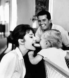 Audrey Hepburn and her son, Sean, entertaining James Garner with their silly antics, 1961.
