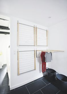 four wall mounted drying racks (from Ikea!) to create an instant indoor drying room - super great space saving idea {remodelista} Laundry Room Design, Laundry In Bathroom, Laundry Rooms, Basement Laundry, Laundry Rack, Laundry Room Drying Rack, Indoor Clothes Drying Rack, Laundry Hanging Rack, Home Organization