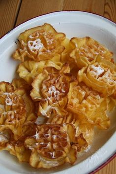 Flores de Mayo. A deep fried pastry sprinkled with sugar. A specialty of Northern Spain. esmetours.com