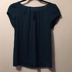 🎀 HP🎀✂️REDUCED FROM $20 to $16 Zara blue top w/key hole & pleating detail.  Zips in the back. Viscose & poly blend.  Dry clean.  Can be dressed up or worn w/jeans! Zara Basics Tops Blouses