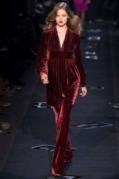Glowing garnet red stretch velvet set. Draped empire tunic and flared pants. Diane von Furstenberg Fall 2013 Ready-to-Wear Collection.