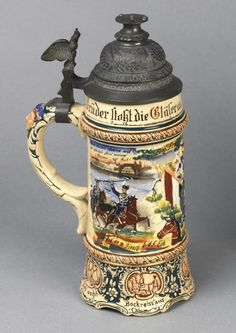 Decorative German bierstein associated with the 'Christmas Truce' held on the British sector of the Western Front around 25-26 December 1914. The bierstein was presented to Private Bill Tucker (Army Ordnance Corps) as 'captain' of a winning British football team after an impromptu friendly match played against German troops.