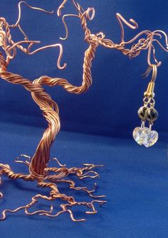 I just bought this wire jewelry tree to hold my earrings. I love that it sort of doubles as a sculpture.