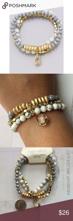 Multi Bead Stacked Stretch Bracelet Brand New Multi Bead Stacked Stretch Bracelet finished with a tear drop semi Precious stone. Nickel and lead free. One size fits most Boutique Jewelry Bracelets: