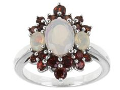 .70ctw Oval Ethiopian Opal With 1.05ctw Round Imperial Zircon Sterling Silver Ring