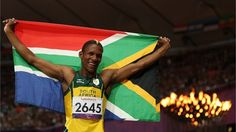 Union Sekailwe of South Africa celebrates winning bronze in the men's - Final on Day 5 of the London 2012 Paralympic Games at the Olympic Stadium 400m, The Man, Olympics, South Africa, Athlete, Celebration, Flag, Bronze, London