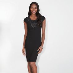 Lace Applique Sheath Dress. The difference is in the details! Fine styling takes the little black dress to a whole new level. A sleek dress with black accessories makes this a perfect versatile dress for any occasion!