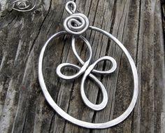 Celtic Cross Holiday Ornament - Aluminum Wire - Christmas Ornament - Celitc Cross Oval Spiral -tree ornament. $15.50, via Etsy.