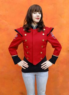 Super cool vintage marching band jacket.  Military style with double row of brass buttons!    Jacket is red and black wool  Black cuffs with