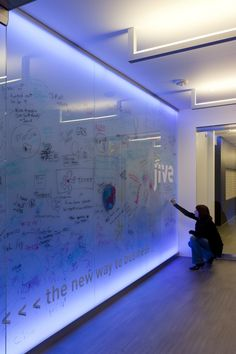 Visitors are met by an illuminated glass wall covered in notes and doodles left by guests and employees. This floor-to-ceiling wall of light is designed to be the spark of emerging ideas. - See more at: http://blog.eoffice.net/2013/08/page/2/#sthash.CWbfutLk.dpuf