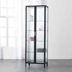 """Shop odean large glass cabinet.   As noted by the designer Ceci Thompson, this piece """"is an industrial take on vintage pharmacy cabinets. """" Ideal in any sized bathroom, fluted glass panes obscure contents but keep things visually light."""