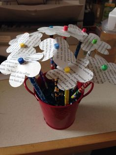 Make flowers pencils or pens by cutting out the pages of old books and attaching them to pens/pencils.  Great arts and crafts activity for any library makerspace.