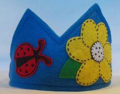 Blue Felt Crown with Yellow Flower and Lady Bugs the on each side. thekidzclothesline on Etsy, $22.50