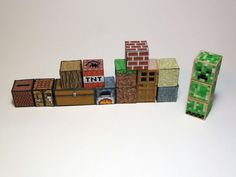 minecraft  I bought some 1″ x 1″ wooden blocks and glued the papercraft printouts onto the blocks. At some point I need to give them a good coat of Modge Podge to give them a sort of varnish.