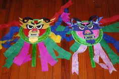 Chinese New Year dragon masks.  I got the pattern for these from http://www.dltk-kids.com/animals/mplate-dragon.htm.  I went to the eye doctor office and got some of those plastic glasses that you get after dialation and cut out an iris for the dragon's eyes and put those glasses behind that.  That way the kids could look through the mask while holding it up.  i also got a paint stick from Lowe's and painted it - for the kids to hold the mask.  Fun to make!