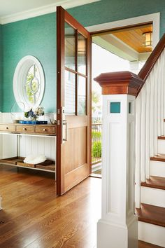 the wainscoting, the door, the colors, the wood,  I love it all.  foyer   Peter Cadoux Architects