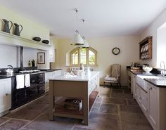 I like the long shelf above the Aga. Some black granite work tops could tie in with the aga? Shiny black bounces light around. A chair in the corner! Handmade Kitchens, Custom Kitchens, Bespoke Kitchens, Home Kitchens, New Kitchen, Kitchen Dining, Kitchen Decor, Kitchen Ideas, Kitchen Mantle