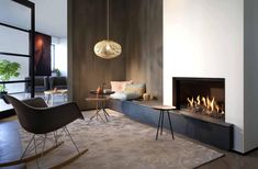 Adorable Gas Fireplace Design Insert On White Wall Including Black Chair On Brown Carpet Including Unique Pendant Lamp Above Small Round Table Stunning Gas Fireplace Ideas for Creating Luxurious Ambiance in Room living room Room Design, Home Fireplace, Fireplace Design, Home Decor, Living Room Interior, Cozy Living, Living Decor, Cozy Living Rooms, White Furniture Living Room