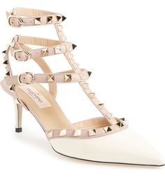 Valentino Rockstud Pointy Toe Pump, in Ivory Patent.  Starting in size 4 at Nordstrom.   Signature rockstuds glint on the caged triple straps of an edgy patent leather pump with a slim kitten heel and pointed toe.