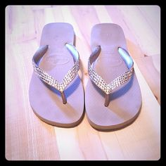 Real Swaroski Crystal flip flops Like new real Swaroski Crystal tan flip flops. Supper comfy and the crystals are a beautiful touch. Worn a few times. Mainly indoors. No scratches or stains. No crystals missing. Size 9-10. I wear a 10 and they just fit. Swarovski Shoes