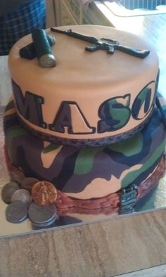 Camouflage Cake with gumpaste ammo, old coins and guns.