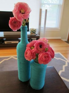 I like the flowers in the vase for a centerpiece. But I think i prefer painted bottles over this DIY Yarn Vases