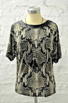 Stunning snake top now at #NicciBoutiques #NicciWinter2015