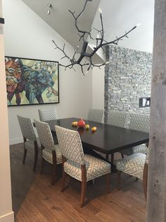 Beautiful dining chairs from Lorts. You can find these chairs at Ernest Gaspard & Associates.  Space designed by Nanci Halper
