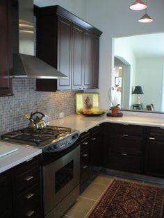 kitchen: white quartz countertops, espresso cabinets, gas stove