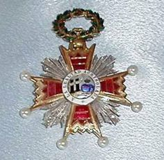 Order of Isabel the Catholic - Grand Cross Badge awarded to Eva Peron by General Francisco Franco on 9 June 1947 in the Oriente Palace in Madrid. (53 mm. Gold, enamels cultured pearls, reconstituted rubies, diamonds) (obverse)