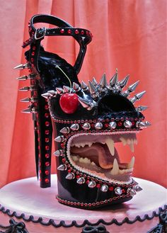 Self Objectification Strategy  Modified Stripper Shoes and Mixed Media, 2012, by Scott Hove